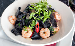 Black squid ink pasta with prawns and chili Royalty Free Stock Images