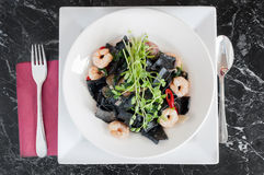 Black squid ink pasta with prawns and chili Royalty Free Stock Photo