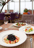 Black squid ink pasta with seafood on table Royalty Free Stock Photography