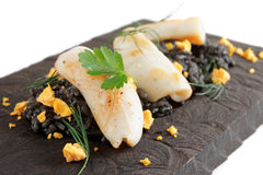 Black squid ink rice and fried calamar Royalty Free Stock Photography