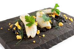 Black squid ink rice and fried calamar Royalty Free Stock Image