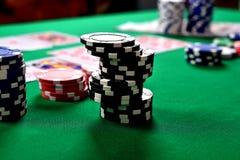 Black stacks of poker chips Stock Photo