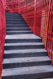 Black staircase and red fence Royalty Free Stock Photos