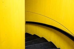 Black staircase with yellw wall background and black bannister. Minimal image royalty free stock images