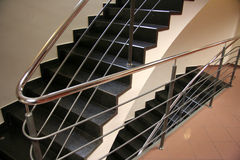 Black stairs. In a modern style hotel Stock Images