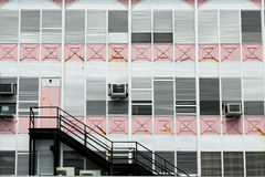 Black Stairs on Old Pink and White Building Royalty Free Stock Photography
