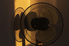 Black stand electric fan. Evening photo with black stand electric fan Stock Photo