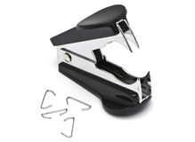 Black staple remover along with some used staples. A black staple remover that just has been used to remove some staple royalty free stock photo