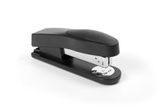 Black stapler. Isolated on a white background royalty free stock photos