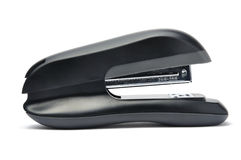 Black stapler. Stapler machine in white background Stock Image