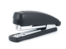 Black stapler. On a white background Royalty Free Stock Photo