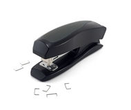 Black stapler isolated on a white background. Office stapler isolated on white and some cramps near stock photo