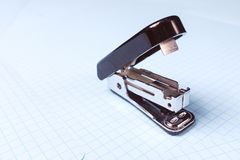 Black stapler  on white background. School and office supplies on the desktop. Copy space. The concept of school and. Preschool education, office work royalty free stock image