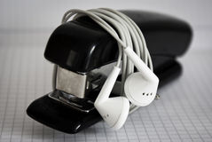 Stapler and headphones Stock Photography