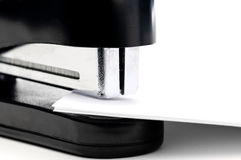 A black stapler with paper Royalty Free Stock Image