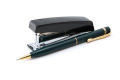 Black stapler and pen`s Stock Images