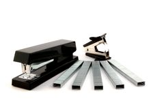 Black stapler, staples and staple remover stock photo