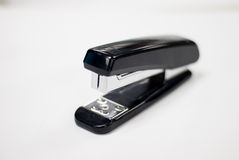 Black stapler in white background Royalty Free Stock Photos