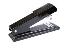 The black stapler on a white background. Office stock on the isolated background royalty free stock images