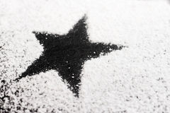 Black star made of sugar Stock Photos