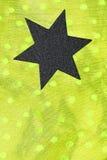 Black star on yellow fabric Royalty Free Stock Photos