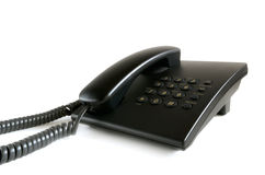 Black stationary phone on a white background. Royalty Free Stock Photography