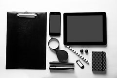 Black stationery and gadgets. On light background Royalty Free Stock Images