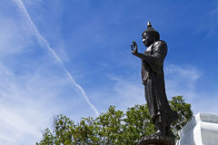Black statue with blue sky Stock Images