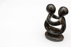 Black Statuette with people embraced on white background Stock Photography