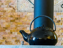 Black steamer kettle wood stove Stock Images