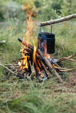 Black Steel Can over Burning Firewood Logs Stock Photography