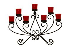 Black steel candlestick with seven red glasses Stock Photo