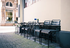 Black Steel Chairs on Grey Concrete Brick Floor during Daytime Stock Images