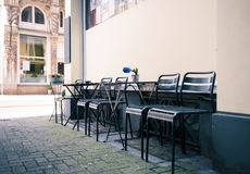 Black Steel Chairs on Grey Concrete Brick Floor during Daytime Royalty Free Stock Images