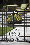 Black steel fence gate. Black steel gate leading to a residential yard stock photography