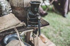 Black Steel Grinder on Brown Wooden Table royalty free stock image