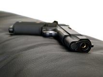 Black Steel Gun on leather Royalty Free Stock Photo