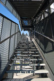 Black steel stairs. Black stairs perspective from the ground to the blue sky Royalty Free Stock Photography