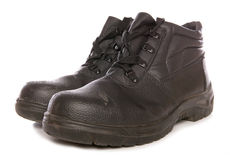 Black steel toecap boots royalty free stock photography