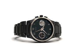 Black steel wrist watch with metal bracelet, close-up