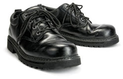 Black Steel toe Work shoes. A pair of black weathered industrial work shoes Stock Photo