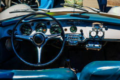 Black steering wheel and a dashboard Royalty Free Stock Image