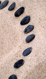 Black stepping stones Royalty Free Stock Photo