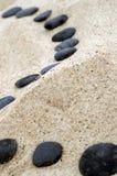 Black stepping stones. Stones on the seashore. Black stepping stones Stock Photos