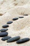 Black stepping stones. Stones on the seashore. Black stepping stones Stock Images