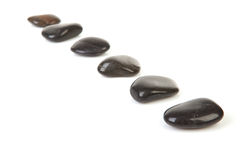 Black stepping stones in a row. Over white background Stock Photos