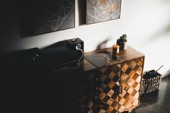 Black Stereo Component on Brown Wooden Dresser Console Royalty Free Stock Image