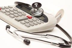 Black Stethoscope on Calculator Royalty Free Stock Image