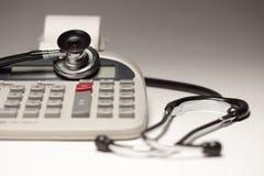 Black Stethoscope on Calculator Stock Photo