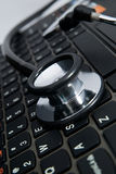 Black stethoscope and keyboard Stock Photos